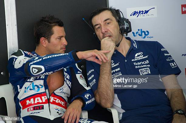 Randy De Puniet of France and Power Electronics Aspar speaks in box during the MotoGP Tests in Sepang Day Three at Sepang Circuit on February 5 2013...