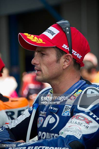 Randy De Puniet of France and Power Electronics Aspar speaks with journalists at the end of the qualifying practice of the MotoGp Of Holland at TT...
