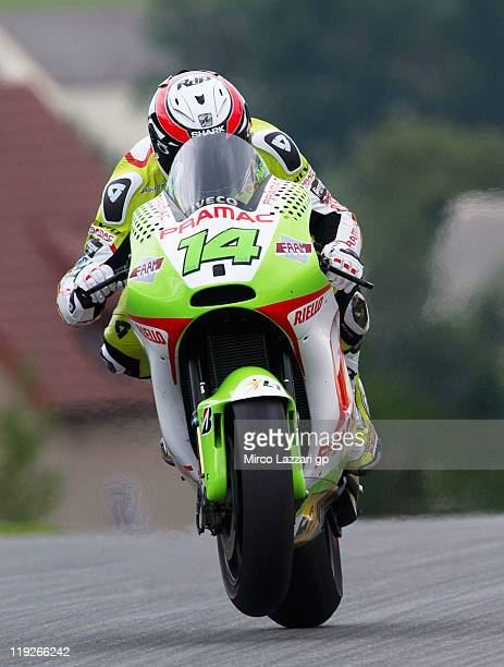 Randy De Puniet of France and Pramac Racing Team lifts the front wheel during the free practice of MotoGP of Germany at Sachsenring Circuit on July...