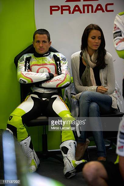 Randy De Puniet of France and Pramac Racing Team looks on in the box during the free practice of MotoGP of Netherlands at TT Circuit Assen on June 23...