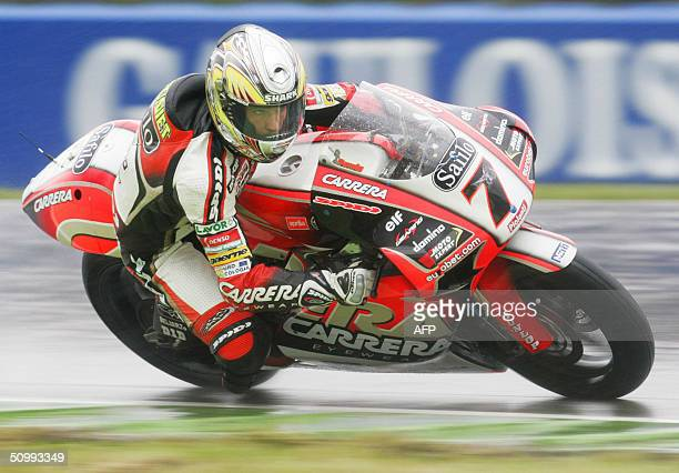 Randy de Puniet of France vies in the third qualifying trial in the 250cc category before the Dutch TT Motorcycle Grand Prix 24 June 2004 The race is...