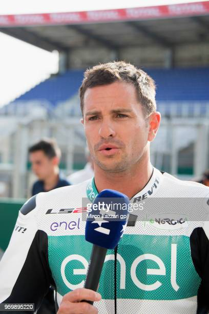 Randy De Puniet speaks with journalists after test the Ebike during the MotoGp of France Free Practice on May 18 2018 in Le Mans France