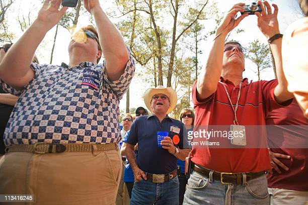 Randy Dean, center, listens to the keynote address by Gov. Bob McDonnell, R-Va., during the 63rd Annual Shad Planking political rally in Wakefield,...