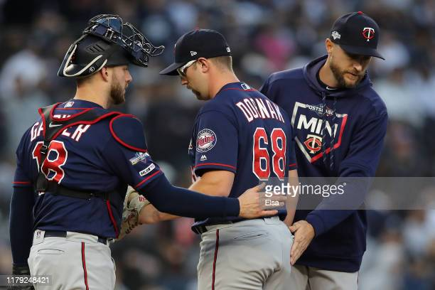 Randy Dobnak of the Minnesota Twins is pulled by Rocco Baldelli after loading the bases in the third inning in game two of the American League...