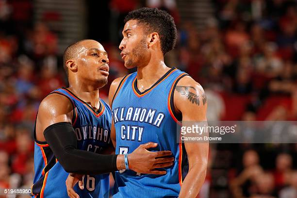 Randy Foye and Josh Huestis of the Oklahoma City Thunder during the game against the Portland Trail Blazers on April 6 2016 at Moda Center in...