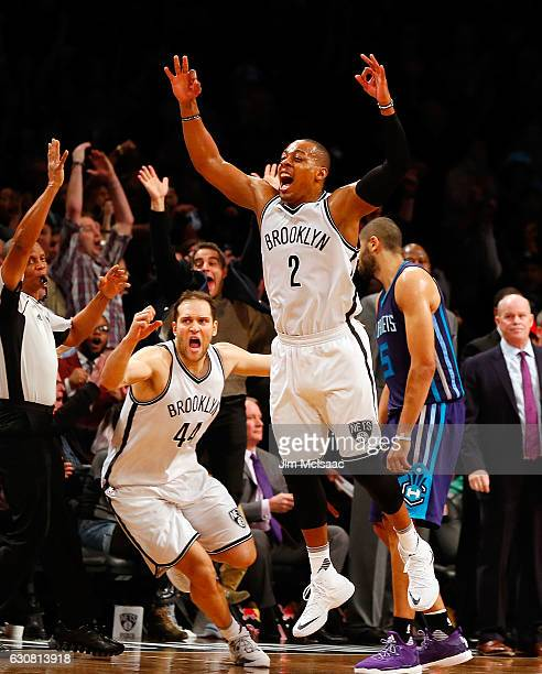 Randy Foye of the Brooklyn Nets celebrates his game winning three point shot at the buzzer against the Charlotte Hornets with teammate Bojan...