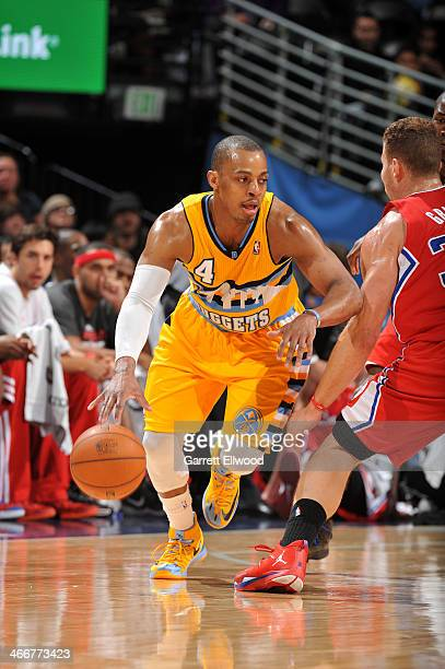Randy Foye of the Denver Nuggets dribbles the ball up court against the Los Angeles Clippers on February 3 2014 at the Pepsi Center in Denver...