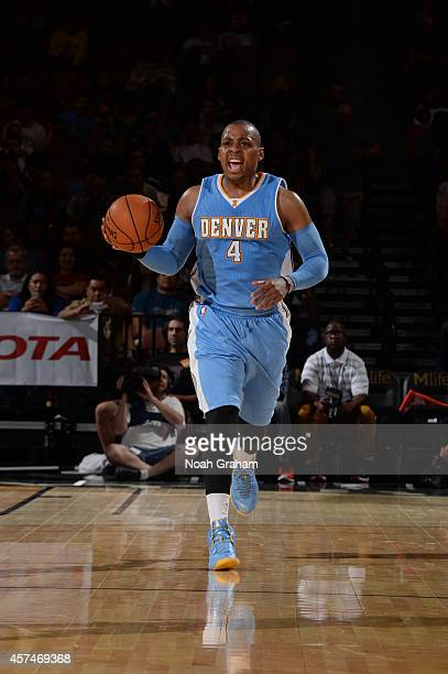 Randy Foye of the Denver Nuggets handles the basketball during a game against the Los Angeles Clippers on October 18 2014 at the Mandalay Bay Events...