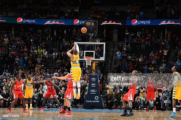 Randy Foye of the Denver Nuggets hits the game winning shot against the Los Angeles Clippers on February 3 2014 at the Pepsi Center in Denver...