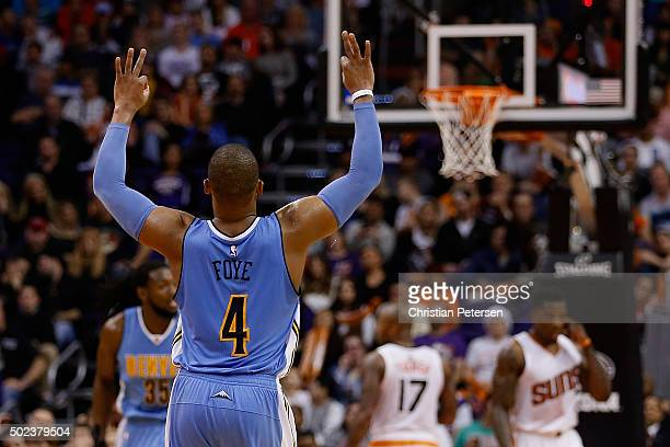 Randy Foye of the Denver Nuggets reacts to a three point shot against the Phoenix Suns during the second half of the NBA game at Talking Stick Resort...