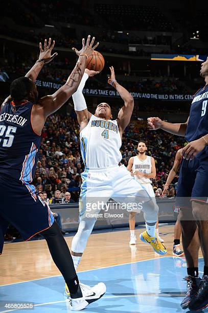 Randy Foye of the Denver Nuggets taking a shot during a game against the Charlotte Bobcats on January 29 2014 at the Pepsi Center in Denver Colorado...