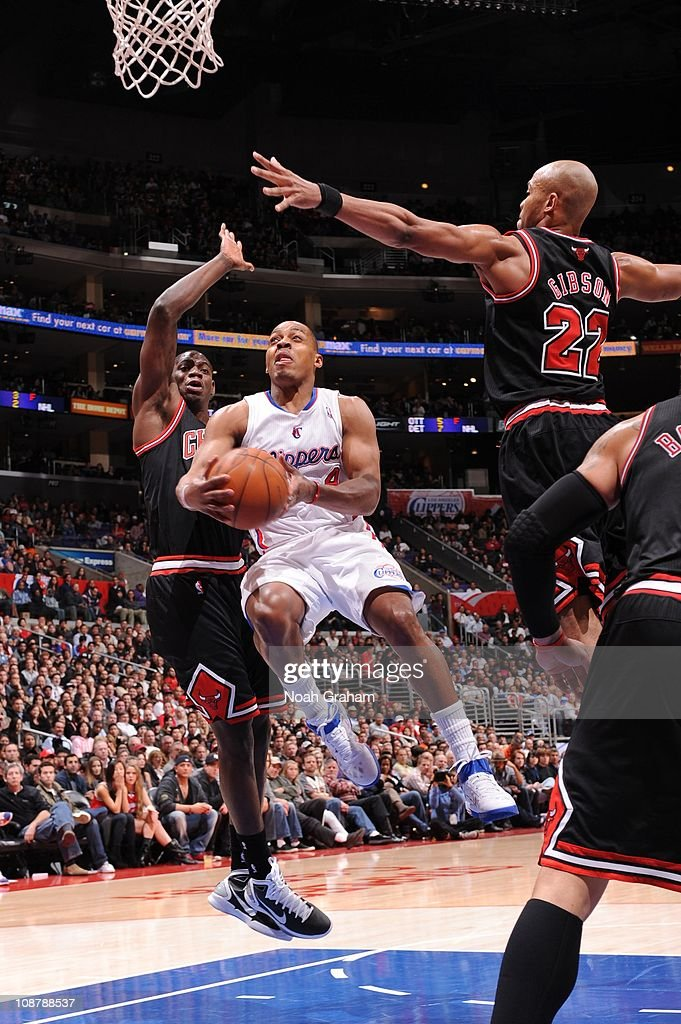 Randy Foye #4 of the Los Angeles Clippers goes up for a shot against Ronnie Brewer #11 and Taj Gibson #22 of the Chicago Bulls at Staples Center on February 2, 2011 in Los Angeles, California.