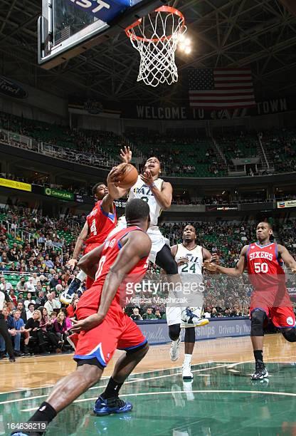 Randy Foye of the Utah Jazz goes to the basket against Jeremy Pargo of the Philadelphia 76ers at Energy Solutions Arena on March 25 2013 in Salt Lake...