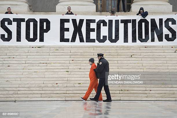 Randy Gardner is removed by police while wearing his executed brother's prison jumpsuit during an anti death penalty protest at the US Supreme Court...