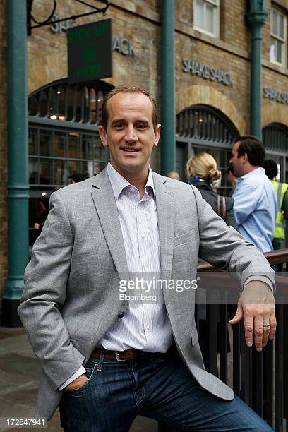 Randy Garutti chief executive officer of Shake Shack poses for a photograph outside the company's new burger restaurant in London UK on Tuesday July...