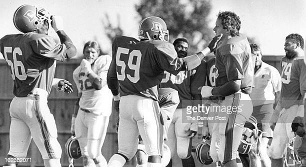 SEP 15 1983 SEP 16 1983 Randy Gradisha receiving a pat from Darren Comeaux has received a commitment to excellence from his fellow Denver Broncos...