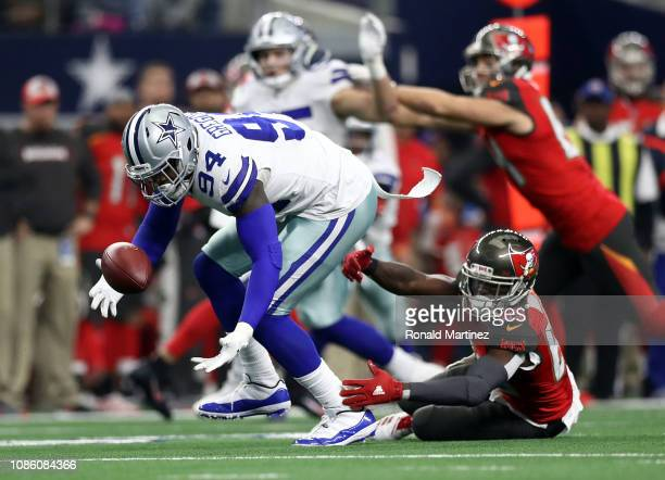 Randy Gregory of the Dallas Cowboys recovers a fumble against Bobo Wilson of the Tampa Bay Buccaneers in the third quarter at ATT Stadium on December...
