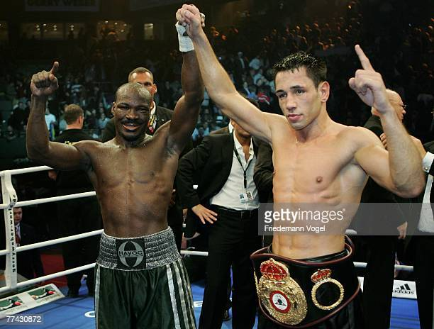 Randy Griffin and Felix Sturm celebrates after the WBA Middleweight World Championship fight between Felix Sturm of Germany and Randy Griffin of the...