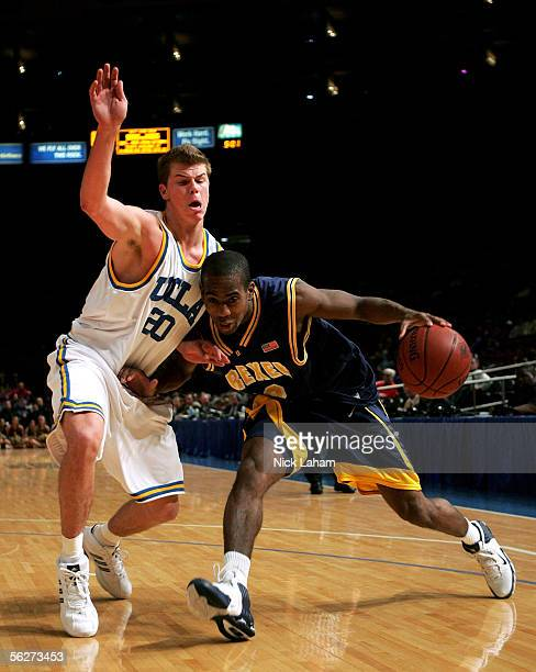 Randy Hampton of the Drexel Dragons drives around Michael Roll of the UCLA Bruins during their Preseason NIT Tournament game at Madison Square Garden...