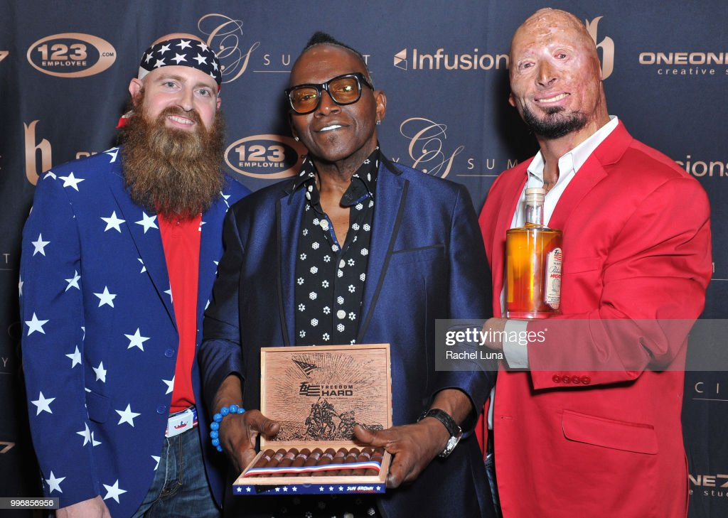 Randy Jackson with veterans Bobby Henline (R) and Chris White (L) pose for a picture at City Summit: Wealth Mastery And Mindset Edition after-party at Allure Banquet & Catering on July 11, 2018 in Van Nuys, California.