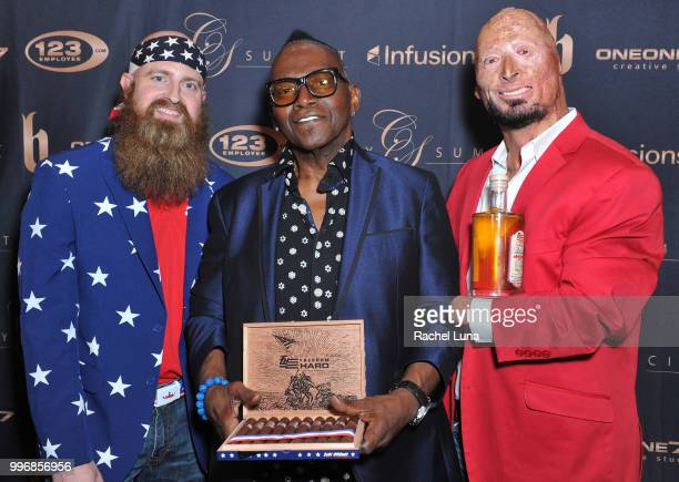Randy Jackson with veterans Bobby Henline and Chris White pose for a picture at City Summit Wealth Mastery And Mindset Edition afterparty at Allure...