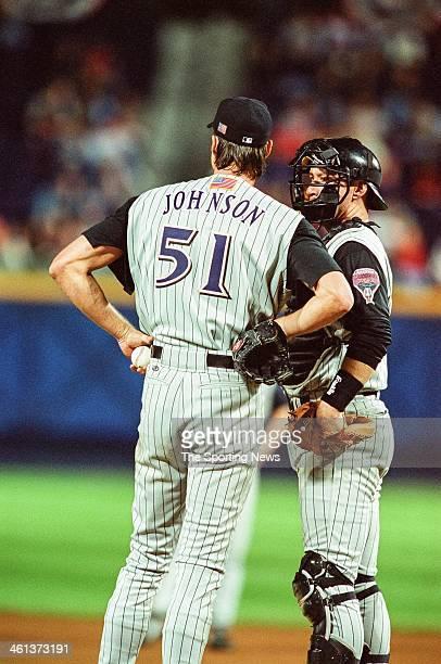 Randy Johnson and Damian Miller of the Arizona Diamondbacks talks during Game Five of the National League Championship Series against the Atlanta...