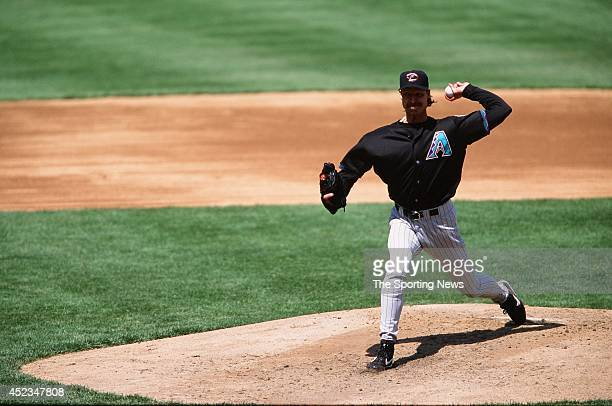 Randy Johnson of the Arizona Diamondbacks pitches against the Chicago Cubs at Wrigley Field on April 30, 2000 in Chicago, Illinois. The Diamondbacks...