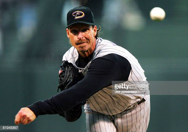 Randy Johnson of the Arizona Diamondbacks pitches against the San Francisco Giants on July 9, 2004 at SBC Park in San Francisco, California.