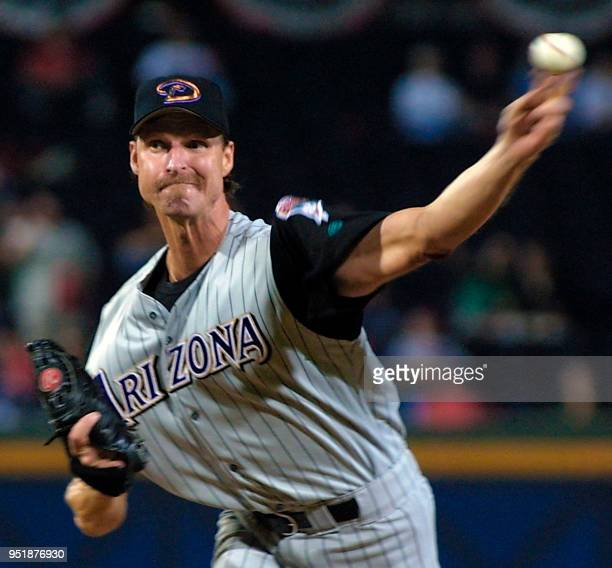 Randy Johnson of the Arizona Diamondbacks pitches to the Atlanta Braves in the 1st inning of game 5 of the National League Championship Series 21...