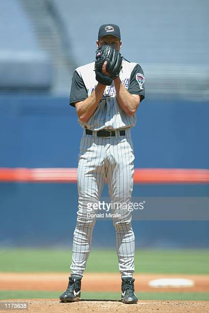 Randy Johnson of the Arizona Diamondbacks prepares to throw against the San Diego Padres during the game on July 21, 2002 at Qualcomm Stadium, in San...