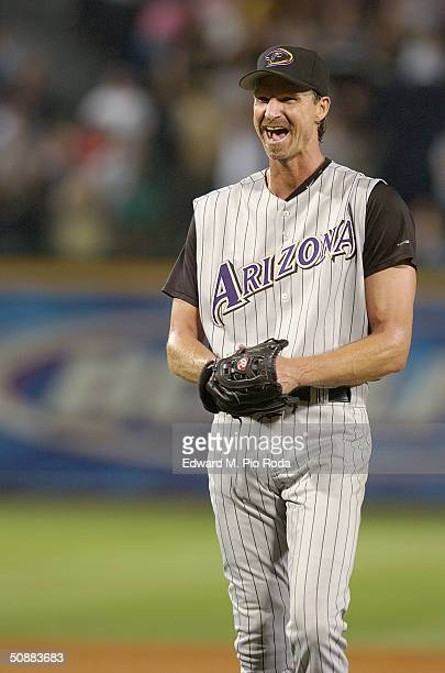 Randy Johnson of the Arizona Diamondbacks smiles after pitching a perfect game against the Atlanta Braves on May 18, 2004 at Turner Field in Atlanta,...