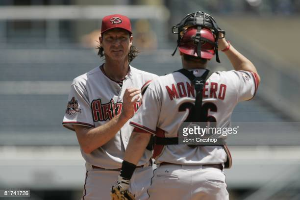 Randy Johnson of the Arizona Diamondbacks talks with teammate Miguel Montero during the game against the Pittsburgh Pirates at PNC Park in Pittsburgh...