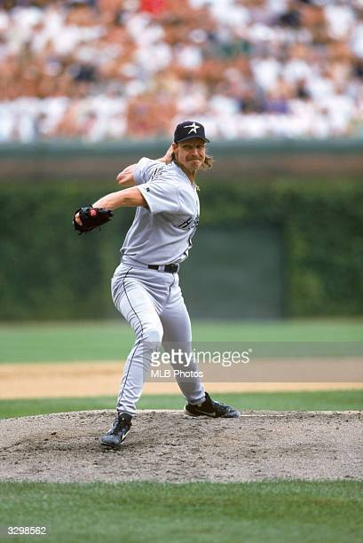 Randy Johnson of the Houston Astros pitches during a Major League Baseball game circa 1998 at Wrigley Field in Chicago Illinois