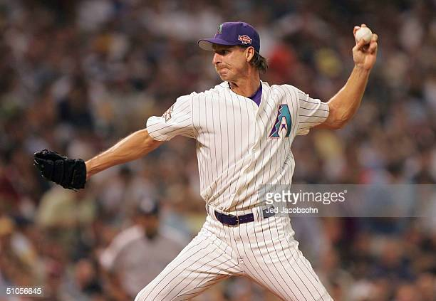 Randy Johnson of the National Team throws a pitch during the third inning of the Major League Baseball 75th All-Star Game at Minute Maid Park on July...