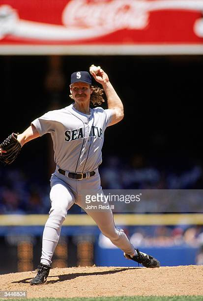 Randy Johnson of the Seattle Mariners pitches during a game against the Detroit Tigers at Tiger Stadium on June 8 1997 in Detroit Michigan The...