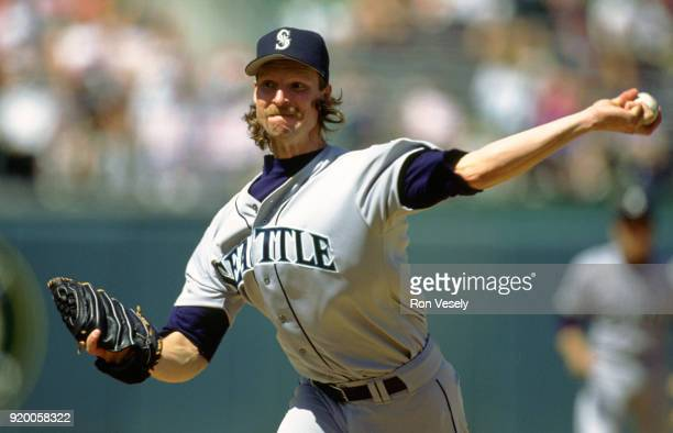 Randy Johnson of the Seattle Mariners pitches during an MLB game against the Oakland Athletics at he OaklandAlameda County Colosseum during the 1993...