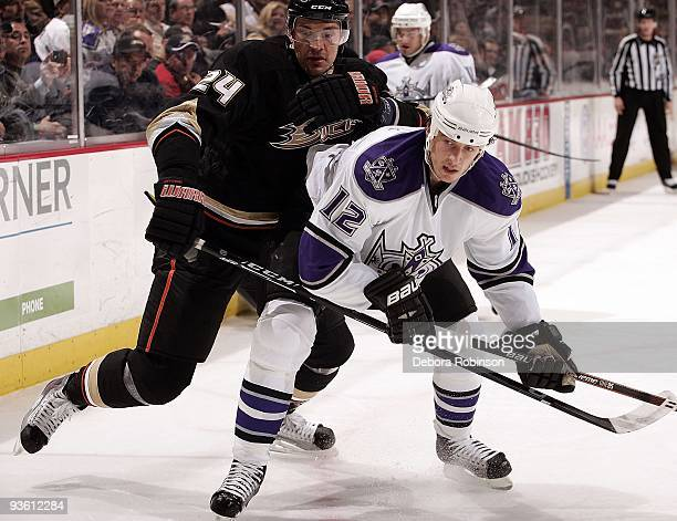 Randy Jones of the Los Angeles Kings battles for position against Evgeny Artyukhin of the Anaheim Ducks during the game on December 1 2009 at Honda...