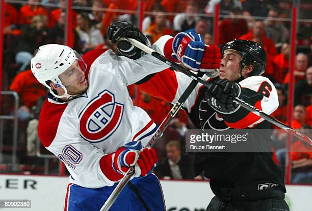 Randy Jones of the Philadelphia Flyers gets the stick up on Maxim Lapierre of the Montreal Canadiens during Game 3 of the Eastern Conference...