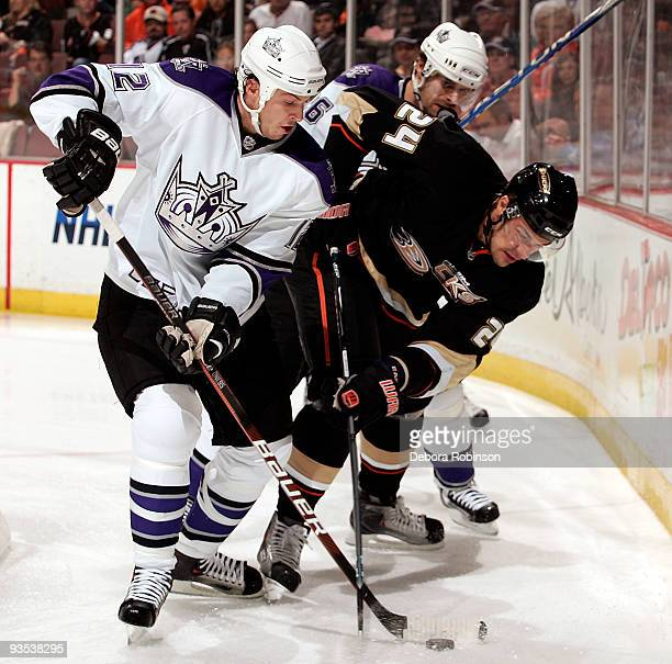 Randy Jones of theLos Angeles Kings defends the puck behind the net against Evgeny Artyukhin of the Anaheim Ducks during the game on December 1 2009...