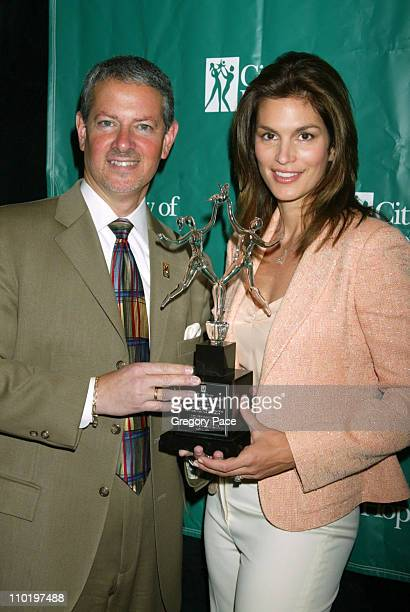 Randy Lapin vice president of Development of Production for City of Hope and Cindy Crawford with her Spirit of Life Award for philanthropy