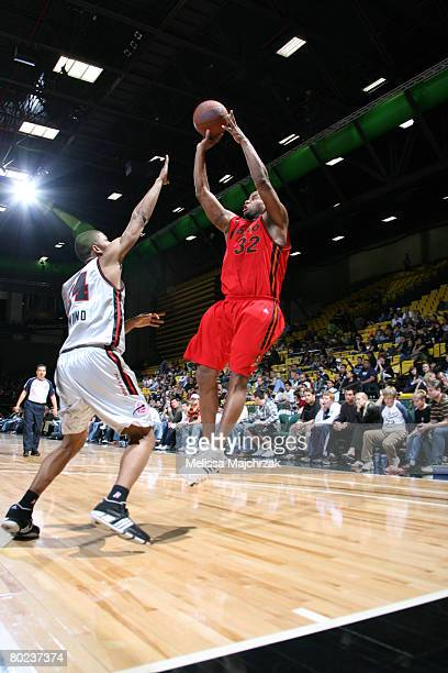 Randy Livingston of the Idaho Stampede puts the shot up over Morris Almond of the Utah Flash on March 13, 2008 at the David O. McKay Events Center in...