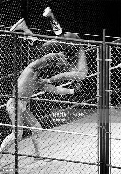 Randy Macho Man Savage body slams Ricky The Dragon Steamboat during their WWF steel cage match circa 1987
