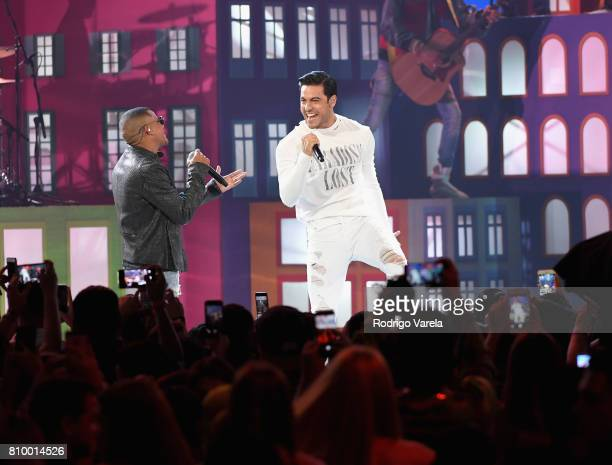 Randy Malcom and Carlos Rivera perform on stage during Univision's 'Premios Juventud' 2017 Celebrates The Hottest Musical Artists And Young Latinos...