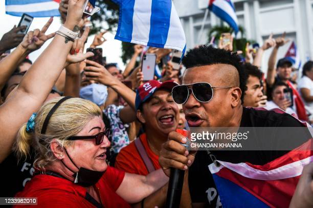"""Randy Malcom of Cuban reggaeton duo """"Gente de Zona"""" greets supporters during during a protest showing support for Cubans demonstrating against their..."""