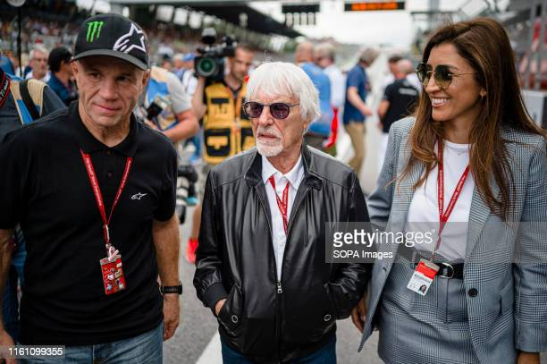 Randy Mamola , former American Grand Prix motorcycle racer, Bernie Ecclestone , Chairman Emeritus of the Formula One Group with his wife, Fabiana...