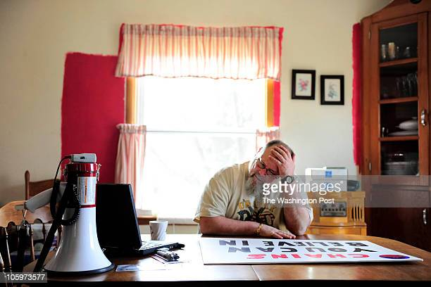 Randy Millam an unemployed Kraft Foods worker prepares to attend a protest rally on the University of Iowa campus where President Obama made a speech...