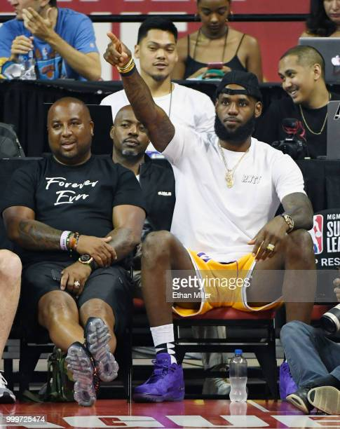 Randy Mims and LeBron James of the Los Angeles Lakers react after a dunk by Johnathan Williams of the Lakers against the Detroit Pistons during...