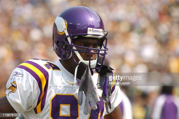 Randy Moss of the Minnesota Vikings looks on during a football game against the Green Bay Packers a at Lambeau Field on September 7, 2003 in Green...
