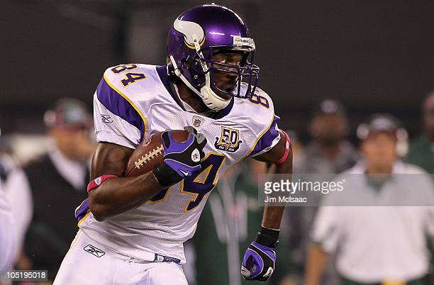 Randy Moss of the Minnesota Vikings runs with the ball in the first quarter against the New York Jets at New Meadowlands Stadium on October 11 2010...