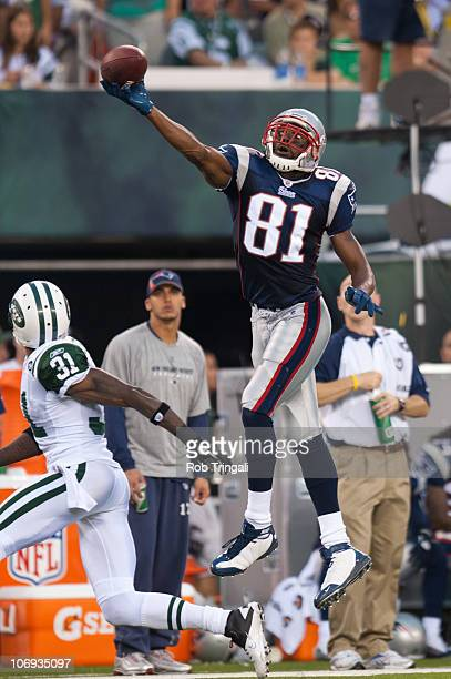 Randy Moss of the New England Patriots attempts to make a catch against the New York Jets on September 19, 2010 at the New Meadowlands Stadium in...